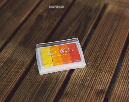 tintas-colores-dedos-huellas-naranja